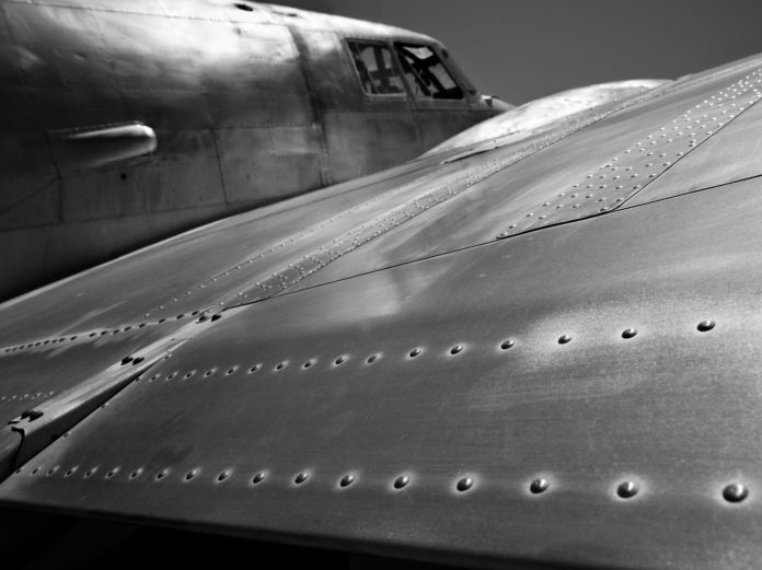 Rivets line the wing of a WWII bomber aircraft.